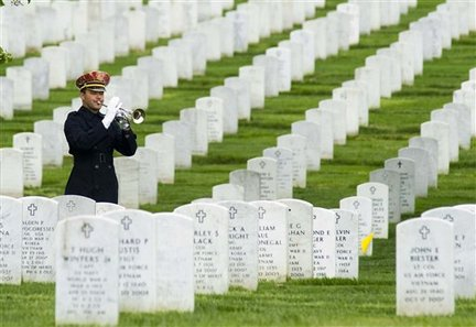 A bugler plays during burial services for Army Staff Sgt. Scott W. Brunkhorst, Tuesday, April 13, 2010, at Arlington National Cemetery in Arlington, Va. According to the Defense Department, Brunkhorst, 25, of Fayetteville, N.C.; died March 30 in the Arghandab river valley, Afghanistan, of wounds suffered when enemy forces attacked his unit with an improvised explosive device. (AP Photo/Kevin Wolf)