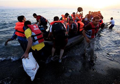 Syrians arrive on the beach at Psalidi near Kos Town, Kos, Greece (AP)